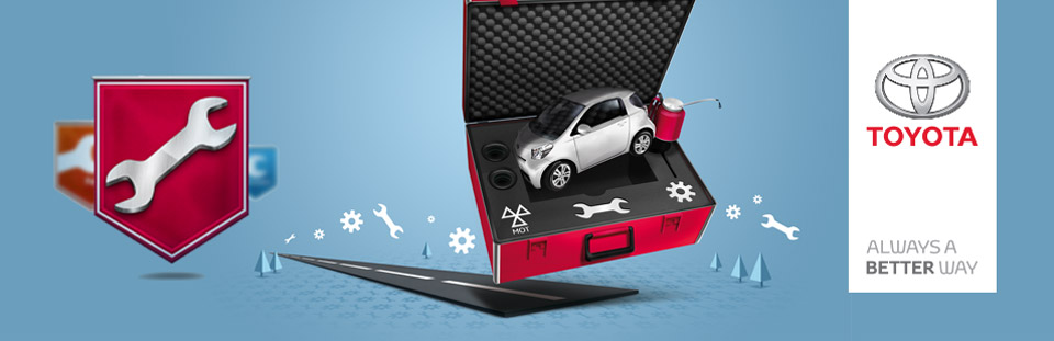Toyota IQ car next to a red toolbox