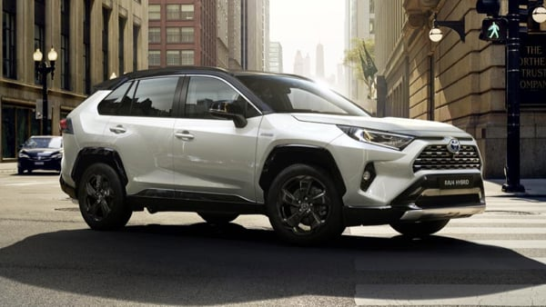 Toyota RAV4 navigating a city intersection.