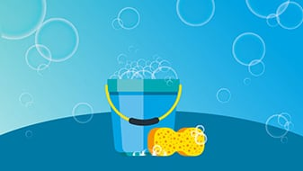 Bucket with sponge and bubbles.